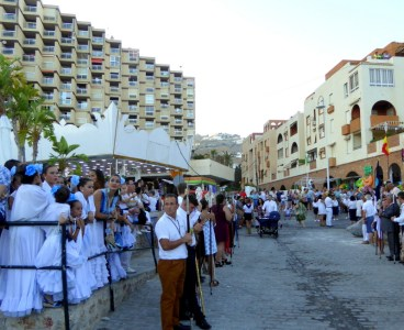 Fiesta Virgen del Carmen 2018 Patrona de Los Marinos Almunecar. On July 16, the day of the Virgen del Carmen is celebrated in Almuñécar.The Virgin is the patron saint of the neighborhood of Los Marinos who, proudly walk their patron saint through San Cristobal. Where they dance and embark her to the Peñón del Santo where fireworks are displayed. Read more on Almunecarinfo.com