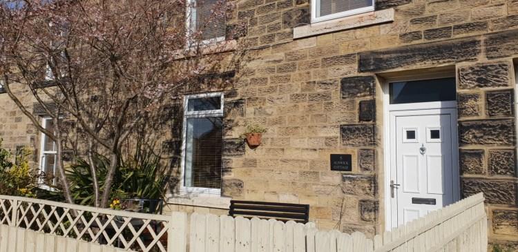 Front door of stone cottage