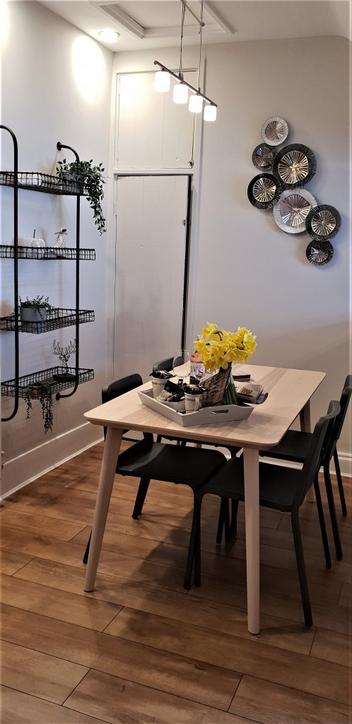 Dining table and wall art in Alnwick Cottage