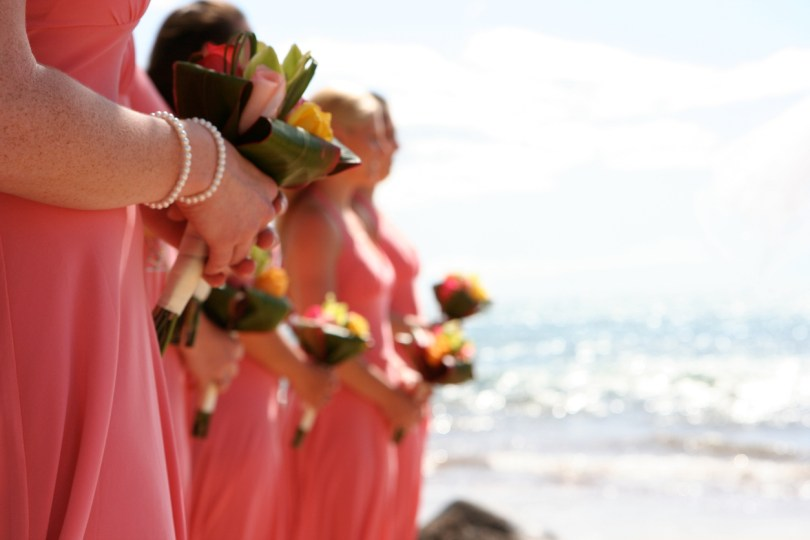 Bridesmaids Holding Bouquets on a sunlit beach