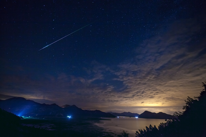 Real falling stars with darkness sky a the sunset