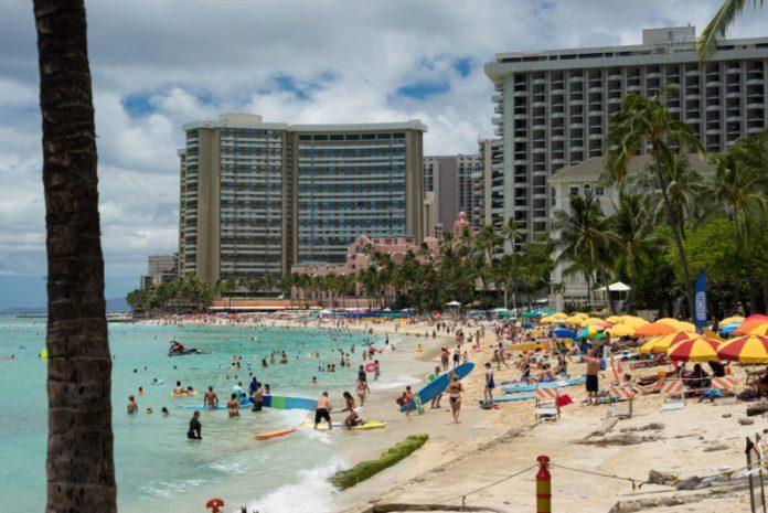 The Waikiki beach crowd   Editorial Credit: Marvin Minder / Shutterstock.com