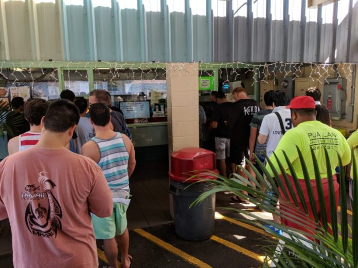 Rainbow Drive-In: Tourists and local residents standing in line for their plate lunch. Hawaii travel. Things to do in Oahu. Things to do in Hawaii.