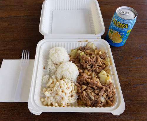 A kalua pig and cabbage plate lunch at Hanalei with a can of cold ice tea! Editorial credit: Bill Morson / Shutterstock.com