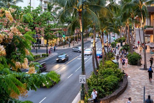 A typical sunny July day for Kuhio Avenue, Waikiki. Editorial credit: Allen.G / Shutterstock.com