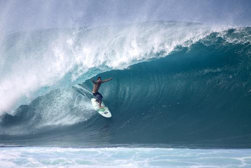 Kalani Chapman competes in the Da Hui Backdoor Shootout at Ehukai Beach (Pipeline). Editorial credit: Mana Photo / Shutterstock.com