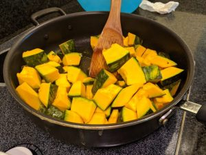 Stir the kabocha until it's completely covered by oil.