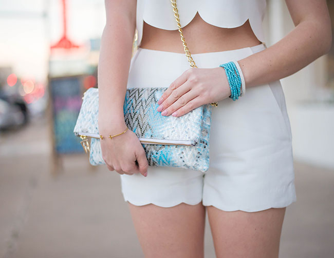 scallop top, scallop crop top, scallop shorts, scalloped shorts, scalloped crop top, scalloped top, turquoise clutch, tory burch wedges, white tory burch wedges, turquoise tassel earrings, tassel earrings, south congress austin, the gypsy wagon austin, university of texas fashion, college fashion, sorority girl, sorority girl fashion, texas girl