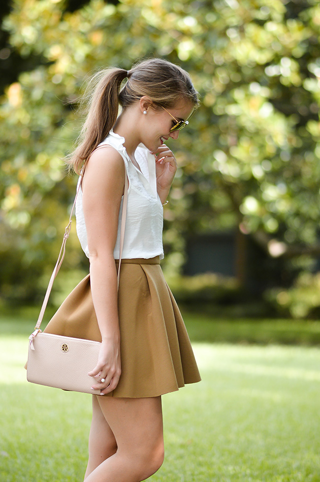 preppy girl, bow flats, bow loafers, miu miu sunglasses, tory burch crossbody, skater skirt, ruffle collar top, southern style, fall style, high waisted skirt, cute pony tail