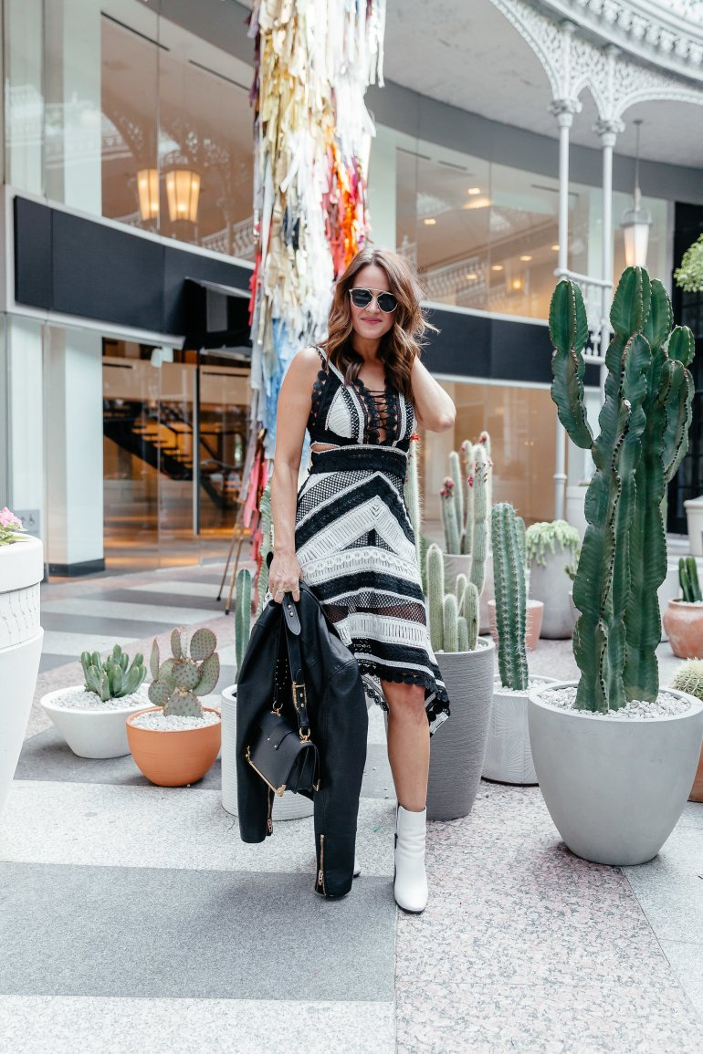 Dallas blogger A Lo Profile wearing a black and white lace dress with white booties