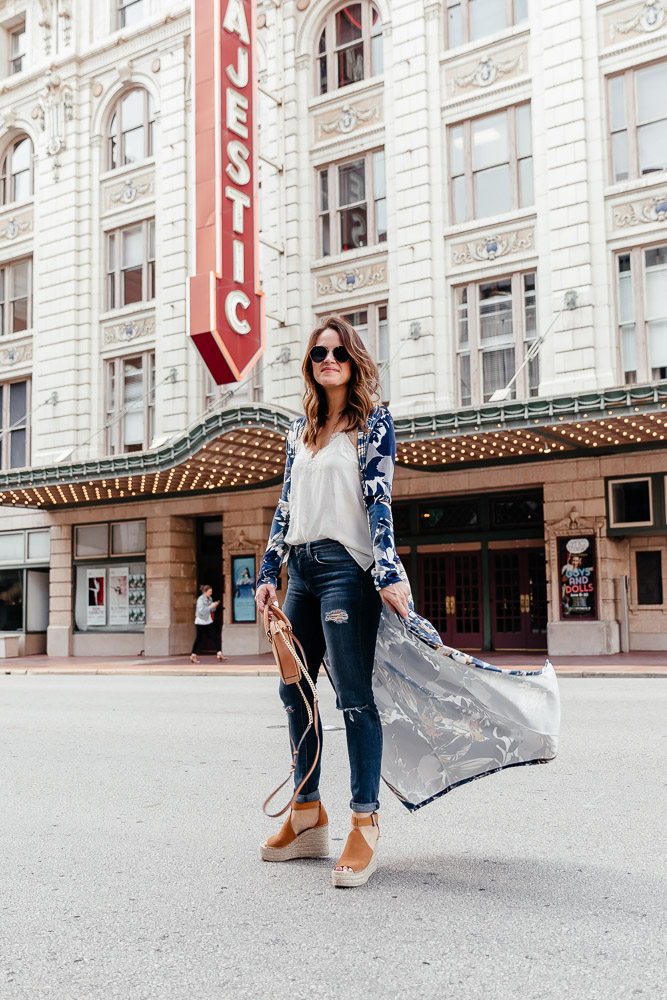A Lo Profile wearing a printed kimono with jeans and wedges