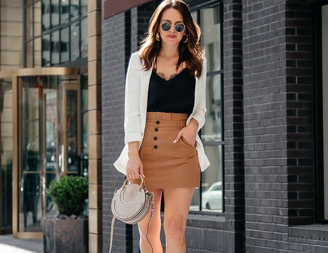 Spring Neutrals: Dallas blogger sharing a spring neutral outfit featuring a tan mini skirt, black cami, white blazer, and gray bag with gold accessories that would make for a perfect date night look. #springstyle #springneutrals #neutralstyle #miniskirt #bloggerstyle