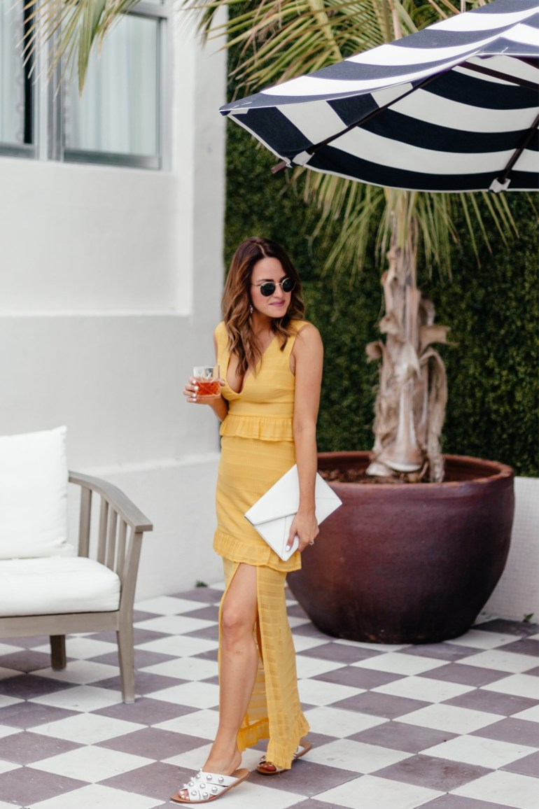 A Lo Profile wearing a yellow maxi dress from Shopbop in Miami