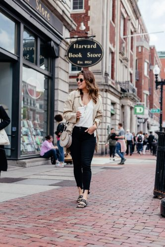 A Lo Profile wearing a tie free people tank, black skinny jeans with raw hem, classic trench coat, steve madden sandals, a leopard headband, and a gray round chloe pixie bag