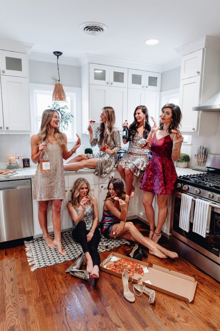 Girls in Sequin dresses having a pizza party