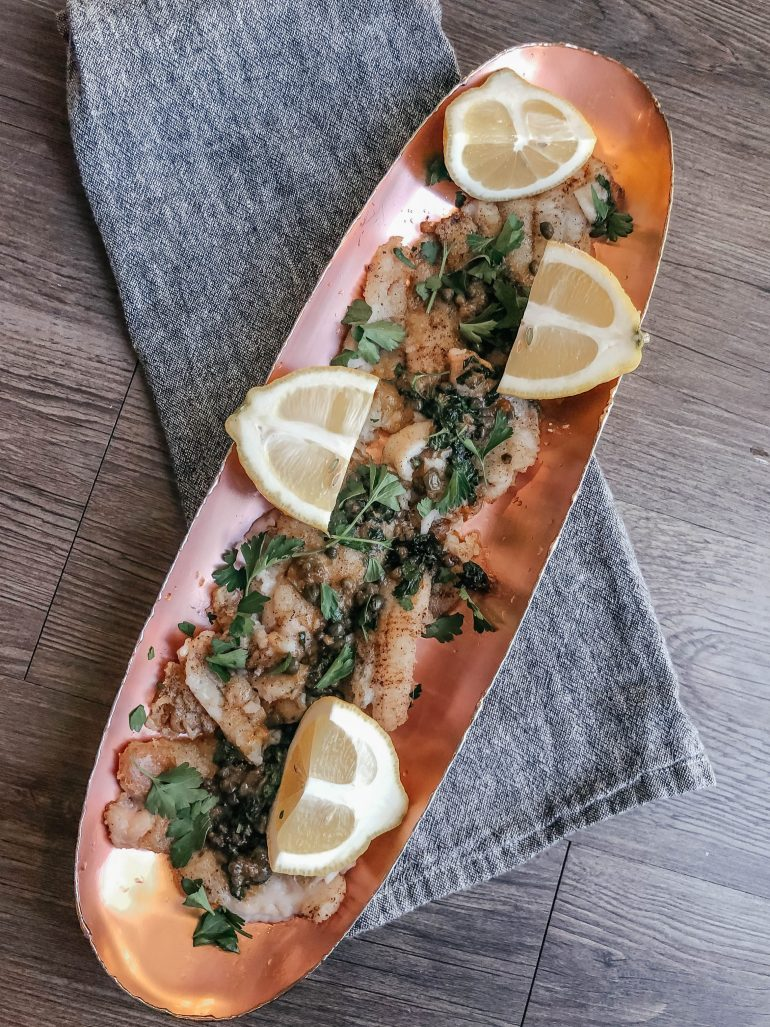 Sharing my easy recipe for Whole 30 sole piccata that is so delicious whether you are doing a Whole 30 or not. It's one of my new favorite recipes!