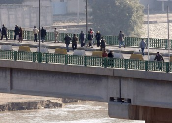 Iraqis walk across the Al-Sinak bridge in central Baghdad after it was temporarily closed to vehicle traffic on February 7, 2010. AFP PHOTO/SABAH ARAR (Photo credit should read SABAH ARAR/AFP/Getty Images)