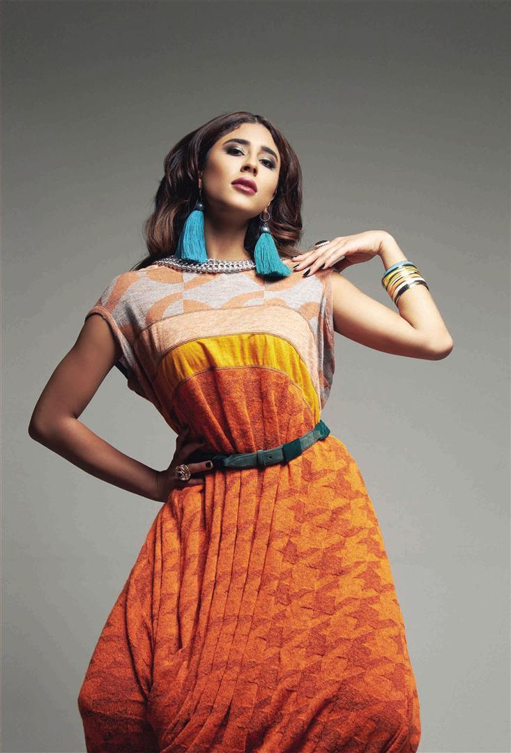 Earrings: Lanvin – Thuraya Mall Dress: Junya Watanabe – Al Ostoura Thuraya Mall Belt: Marco de Vincenzo – Al Ostoura Thuraya Mall