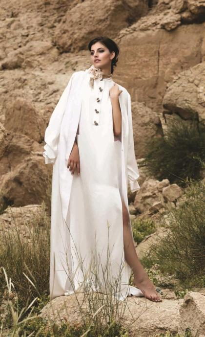 DRESS: Lanvin - Thuraya Mall COAT: August Getty - Al Ostoura Thuraya Mall NECKLACE: Lanvin Thuraya Mall