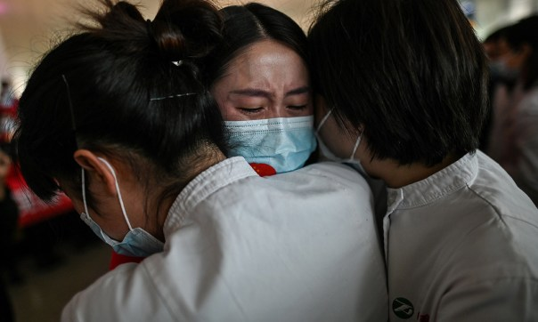 </p> <p>Medical workers in Wuhan embrace. 8 April 2020. <em>Photo by Hector Retamal/AFP/Getty</em></p> <p>