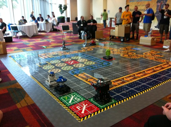 Someone made a huge Robo-Rally game mat with by LEGO Minstorm robots. You actually could play, programing the robots per the board game rules!