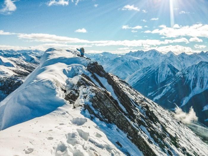 Descending the summit ridge of Vermillion Peak ski