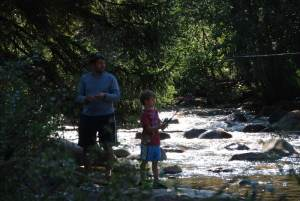 A.J. and dad trying to catch a whopper. by: Cori Kline