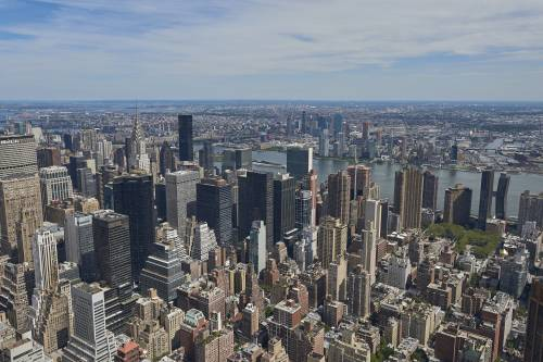 New York, USA seen from above on a sunny day with blue skies