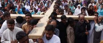 Pakistani Christians carry a cross during a Mass on Good Friday in Quetta, Pakistan on April 6, 2012. Christians around the world are marking the Easter holy week. (AP Photo/Arshad Butt)