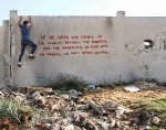 Banksy Sneaks Into Gaza To Create Controversial Street Art