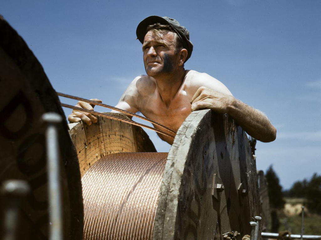 Life at Fort Knox in 1942 -17. A worker puts in a new power line at the rapidly-expanding Fort Knox.