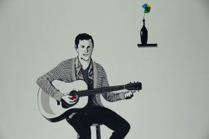 creative painting of person playing guitar
