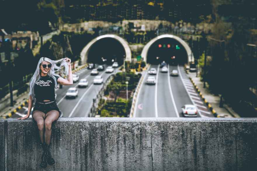 woman wearing black shirt sitting across highways