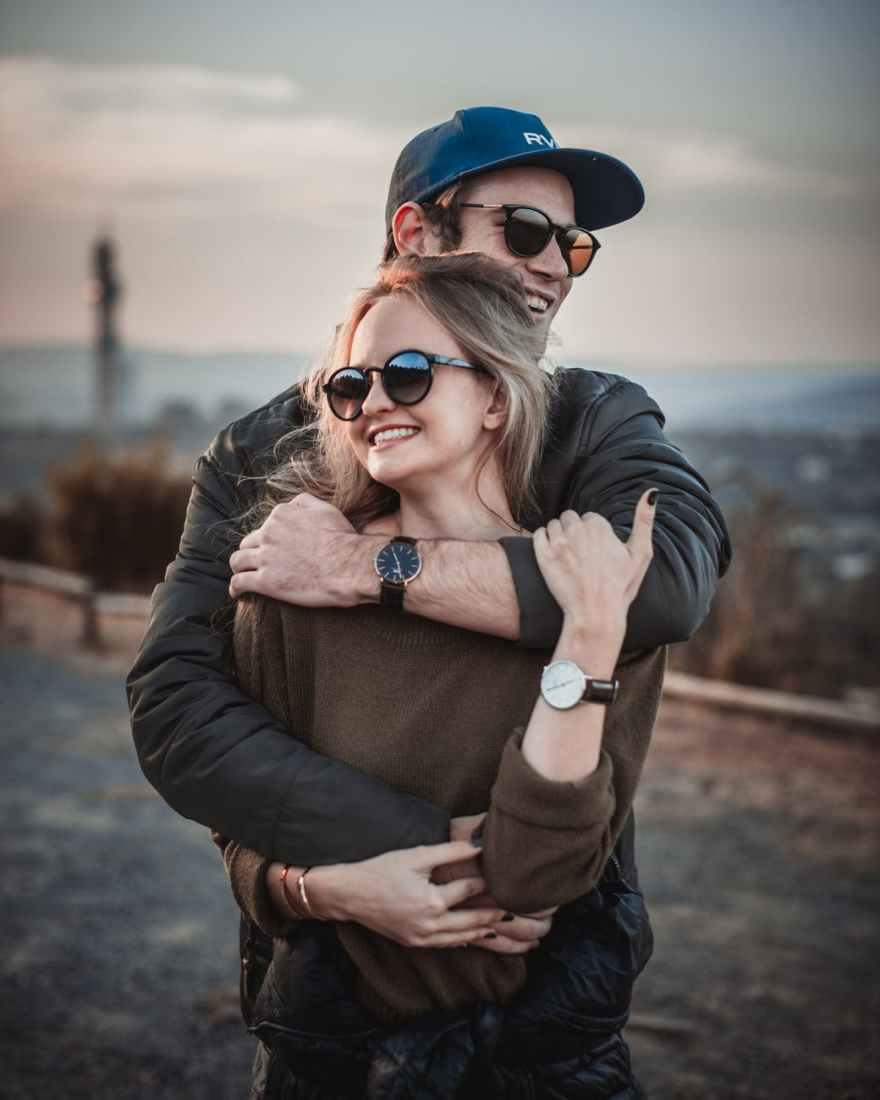 selective focus photo of hugging couple posing