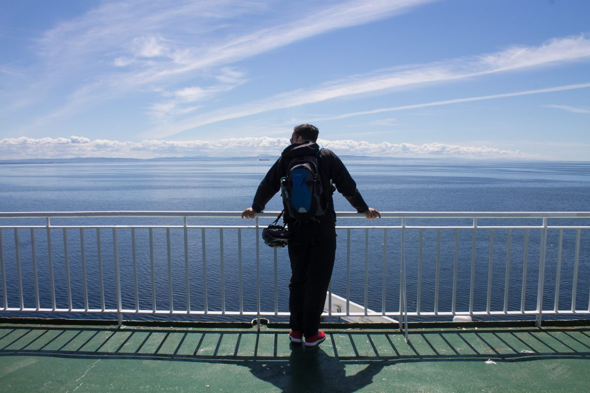 Standing on the ferry crossing the Firth of Clyde | AlternativeTravelers.com