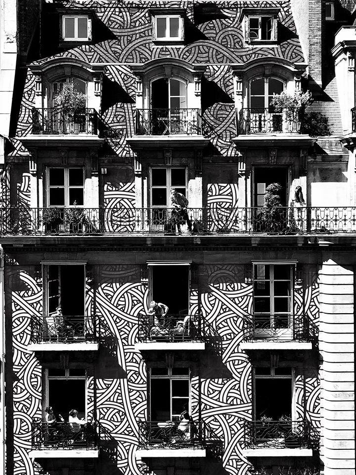 Photo d'immeuble parisien entièrement repeint par le Street Artiste Jordan Saget