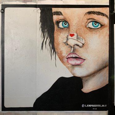Visage d'enfant réalisé par le Street Artiste L'Empreinte Jo V à Paris