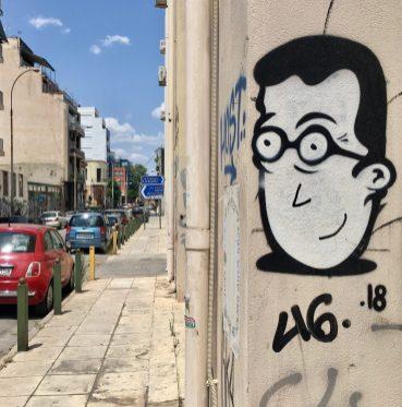 Visage peint par le street artiste RTM à Athènes