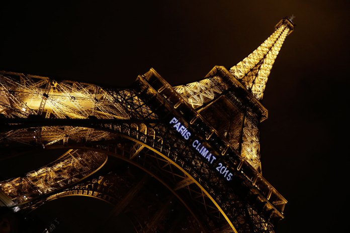 Lights on the Eiffel Tower read,