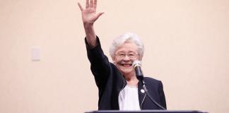 Kay Ivey waving