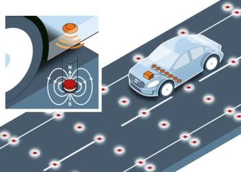 Magneter i kørebanen skal fungere som en slags jernbaneskinne, som de selvkørende biler følger