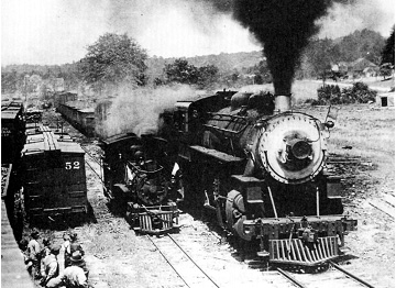 Standard gauge Maine Central 2-8-0 #510 and 2ft narrow gauge Bridgeton & Harrison 2-4-4T #5 vividly demonstrate the difference in this 1927 photo.