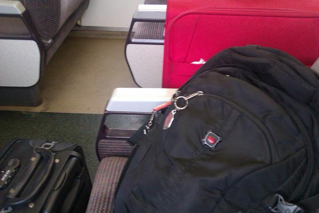 Three of my luggage: back pack, big suitcase (red), dan small suitcase (black)