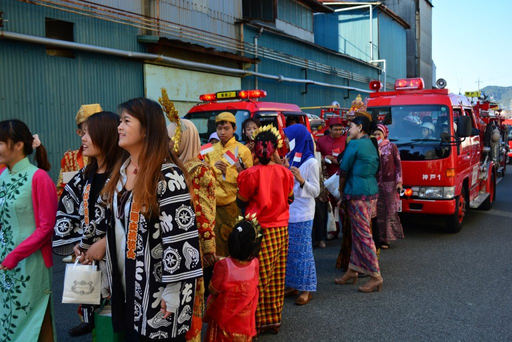 Indonesian delegation parade right in front of the fire fighter's truck