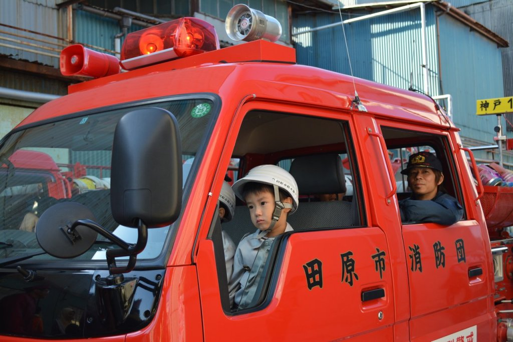 Children on the fire fighter truck on the Japanese festival in Tahara city