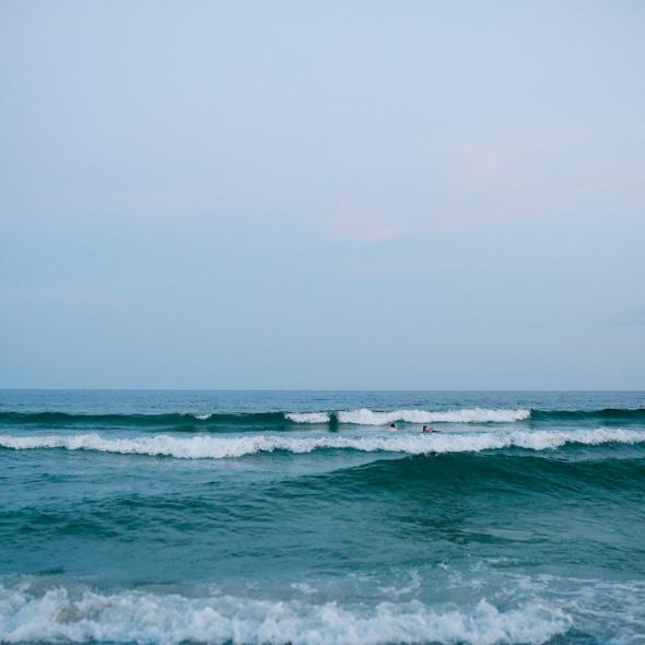 Altrui surfers in waves