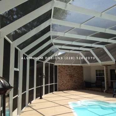 A curved pool enclosure Built by Aluminum Designs of Saucier, MS.