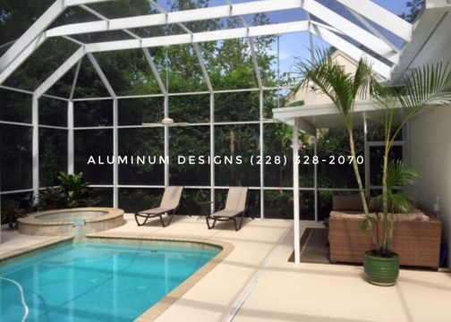 pool enclosure with a patio cover, both built by Aluminum Designs of Saucier, MS.