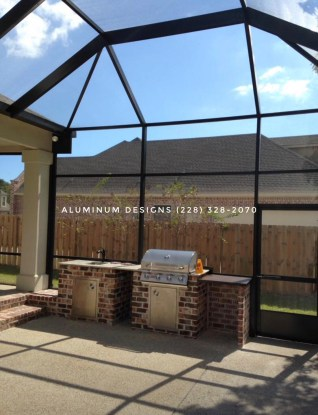 screened outdoor grill area and  lanai with insect screen, bronze frame, structural gutter, chair rail