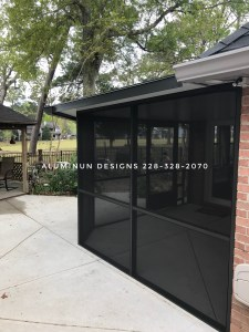 Insulated roof with screened patio eclosure built by  Aluminum Designs of Saucier, MS.